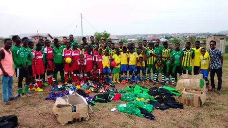 Players for the Humble Lions from Ghana wearing a selection of the kits and boots donated by teams.