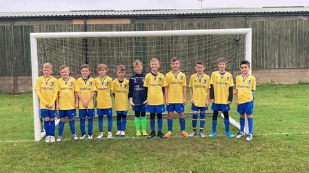 The Norwich United Under 10s squad have helped to donate more than 100 football kits and 50 pairs of boots to a team in Ghana.
