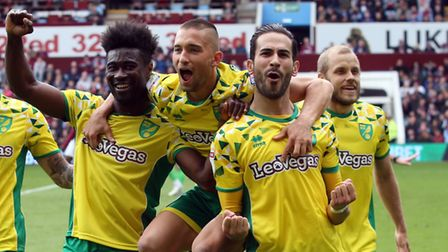 Norwich City midfielder Mario Vrancic is mobbed by team mates after scoring in the title clinching win at Aston Villa in...