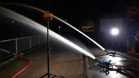 Water being pumped by hoses