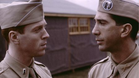 Damian Lewis as Richard D Winters and David Swimmer as Herbert M Sobel in episode 1 of Band of Brothers.