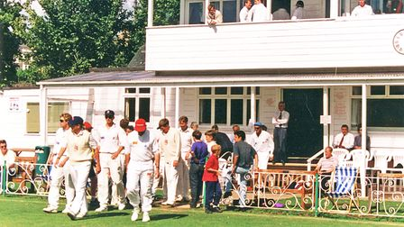 Graham Gooch leads out the Essex team at the Recreation Ground.
