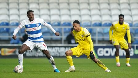 Queens Park Rangers' Bright Osayi-Samuel and Fulham's Kenny Tete battle for the ball during the Emir