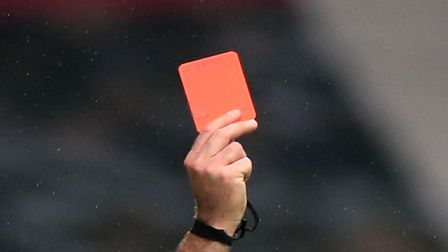 Referee shows a red card in a Premier League game
