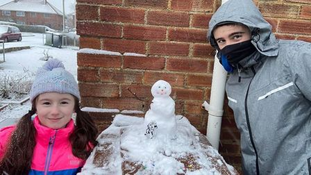Spencer and Tamara from Wymondham with their pocket-sized snowman.