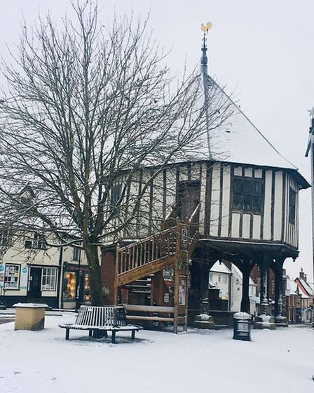 A blanket of snow covered the Market Cross in Wymondham.