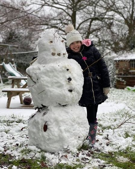 Ayesha from Attleborough with her snowman.