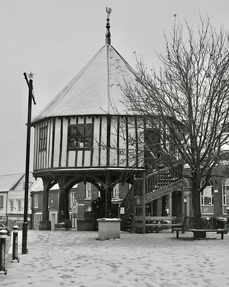 Wymondham's Market Cross in black and white after the snow had fallen.