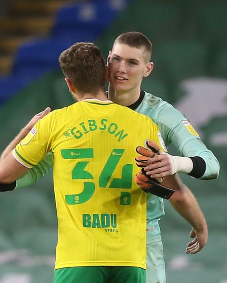 Ben Gibson of Norwich and Daniel Barden of Norwich at the end of the Sky Bet Championship match at t