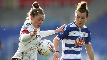 Arsenal's Kim Little and Reading's Angharad James battle for the ball