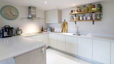 Features of the fitted kitchen include granite worktops.