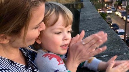 Lucy Wood and her son Lochie clap for carers in Stoke Newington