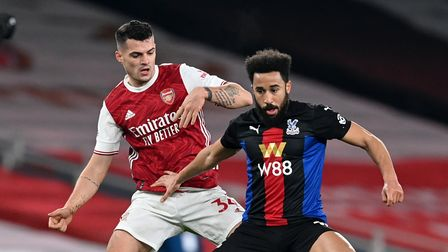 Arsenal's Granit Xhaka (left) and Crystal Palace's Andros Townsend battle for the ball during the Pr