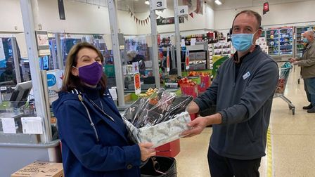 Hub DirectorSarah-Lou Glover collects the Christmas hamper from Honiton's Tesco store