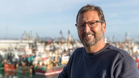 Chef Mitch Tonks with Brixham harbour in the background
