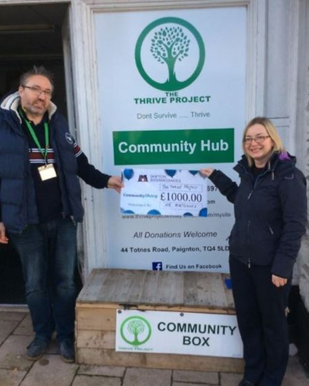 Mark Shephard from the Thrive Project is presented with a cheque by Caroline Rainey from Mr Mortgages