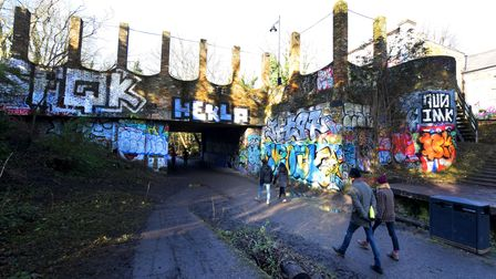 The former Crouch End Station buildings in the Parkland Walk are decorated by brightly coloured graffiti.
