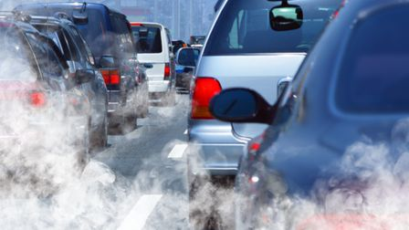 Traffic in a queue, belching out emissions from exhausts