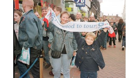 Robert Beavis and mum Linda holding high a Status Quo scarf outside HMV Ipswich when the band visited in 1999