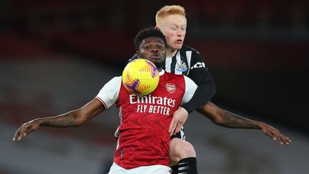 Arsenal's Thomas Partey and Newcastle United's Matty Longstaff battle for the ball