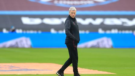 West Ham United manager David Moyes looks on over the warm up before the Premier League match at the