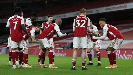 Arsenal's Pierre-Emerick Aubameyang (right) celebrates with his team-mates after scoring his side's