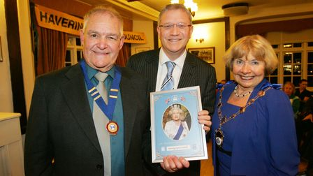 A portrait of the Queen presented to Peter Bruce and mayor cllr Lynden Thorpe by Andrew Rosindell MP