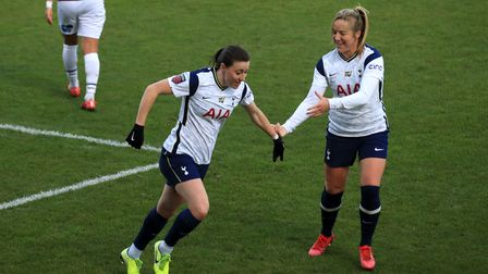 Tottenham Hotspur's Lucy Quinn (centre) celebrates scoring her side's first goal of the game during