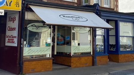 The exterior of Hammond's Café in Paignton, with entrance in the middle of large awning over double bay windows