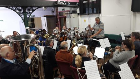 Conductor Andrew Harris taking the band through a rehearsal in 'The Station' before the pandemic