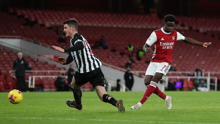 Arsenal's Bukayo Saka scores his side's second goal of the game during the Premier League match at t