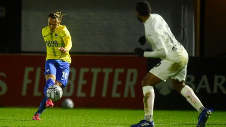Armani Little of Torquay United has a shot during the FA Trophy Second Round match between Boreham W