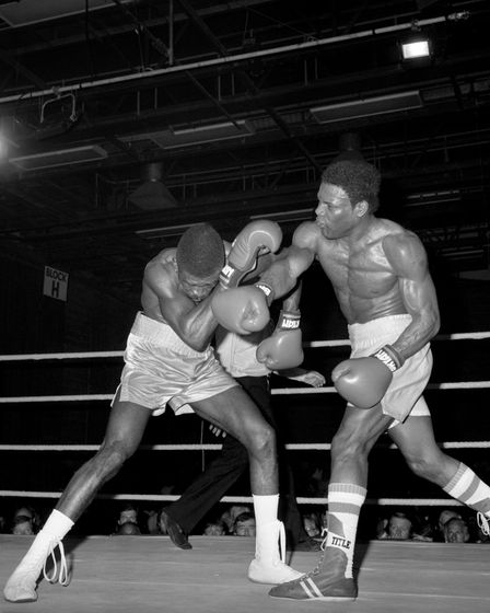 Dennis Andries of Great Britain, right, on his way to victory over the defending champion, American