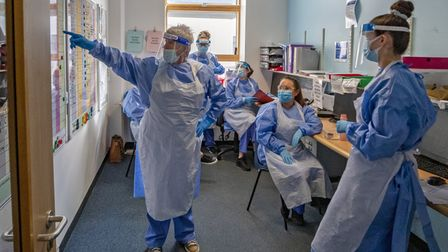 Nurses hold a meeting on a Covid-19 ward. Picture: PA