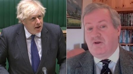 Boris Johnson (L) and SNP Commons leader Ian Blackford during Prime Minister's Questions