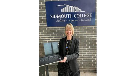 Sidmouth College Principal Sarah Parsons with one of the donated laptops
