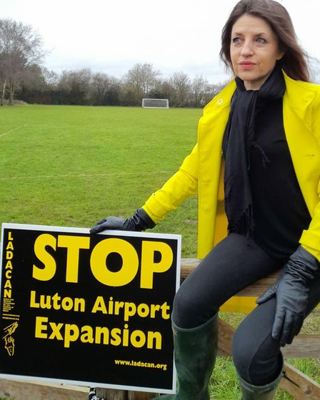 Annie Brewster holding LADCAN sign against Luton Airport expansion