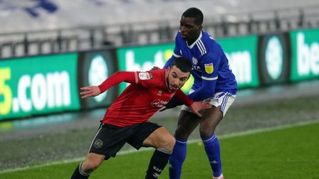 Cardiff City's Sheyi Ojo and QPR's Ilias Chair battle for the ball