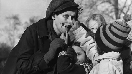Author Astrid Lindgren has her nose pulled by a young fan