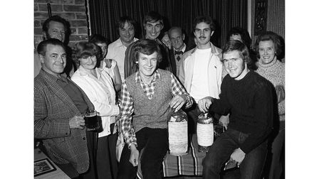 Charity bottles are opened at the Griffin pub in Yoxford by speedway riders in September 1981