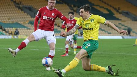 Alfie Mawson of Bristol City and Jordan Hugill of Norwich in action during the Sky Bet Championship