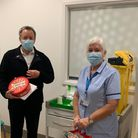 Robert Read, who works for NELFT with vaccinator, Sharon and his tub of celebrations.