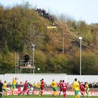 Bristol - Saturday November 7th, 2009: Fans watch from a nearby hill during the FA Cup 1st round mat