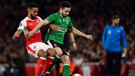 Arsenal's Theo Walcott (left) and Lincoln City's Sam Habergham during the Emirates FA Cup quarter fi