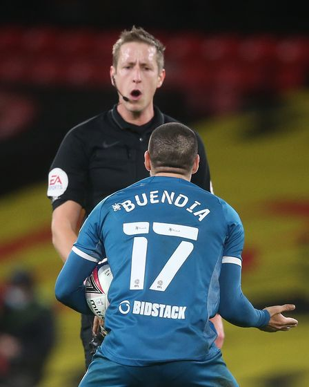 Emiliano Buendia of Norwich reacts to Referee John Brooks during the Sky Bet Championship match at V