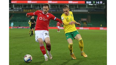 Michael Sollbauer of Barnsley and Przemyslaw Placheta of Norwich in action during the Sky Bet Champi