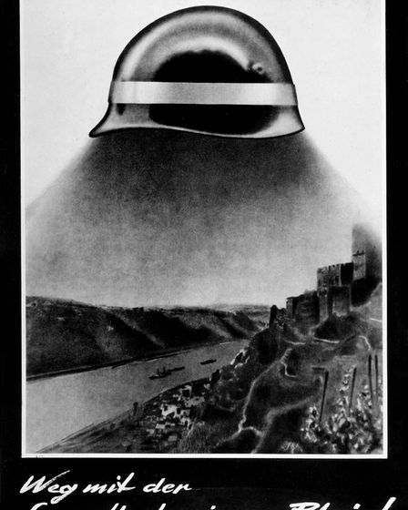 Photomontage by John Heartfield (1891-1968)., 'Sun eclipse over the Rhine river', The American helme