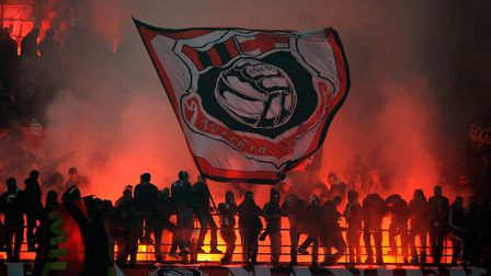 MILAN, ITALY - NOVEMBER 14: Fans of AC Milan show their support during the Serie A match between FC