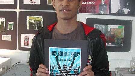 Hopwood Hall College graphic design student Yasin Mohammed with his winning design.
