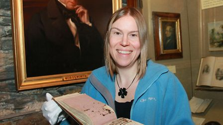 Dove Cottage Education Officer, Catherine Kay, holding Dorothy Wordsworth's diary entry on the day o